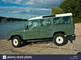 side view of classical land rover defender 110 off road vour wheel