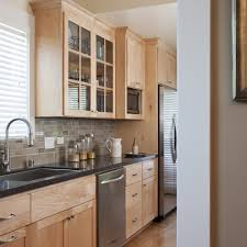 maple cabinets with microwave drawer hanging glass pendant