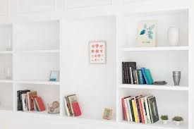 how to decorate a bookshelf expert tricks readers digest replace