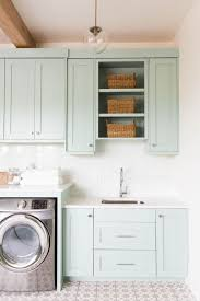 Laundry Room White Cabinets by Light Blue Cabinets Installed In The Laundry Room With White