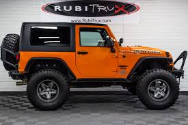 pre owned 2013 jeep wrangler sport turbo orange crush