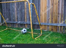 backyard children soccer goal wood fence stock photo 140929996