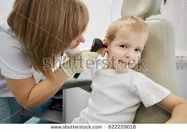 Medical Armchair Dentist Dental Assistant Examining Xray Image Stock Photo