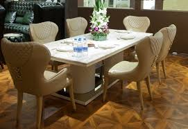 cream leather tufted dining room chairs with white dining table