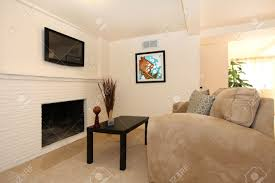 Room With Tv Simple Living Room With Tv And Fireplace With Beige Sofa Stock