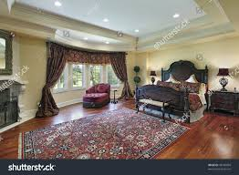 luxury master bedroom recessed ceiling fireplace stock photo luxury master bedroom with recessed ceiling and fireplace