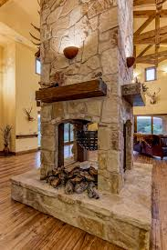 pass through fireplace pass through fieldstone fireplace with
