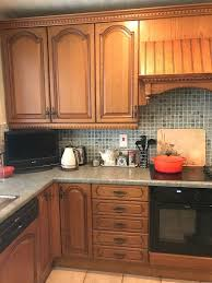 solid medium oak kitchen including intergrated neff appliances and