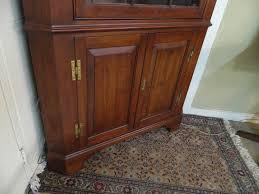 henkel harris solid wild black cherry corner cabinet 12 pane