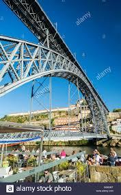outdoor terrace bar cafe and landmark bridge in ribeira riverside