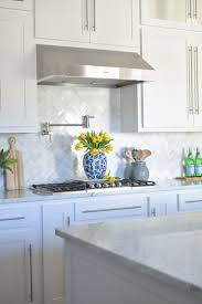 kitchen with mosaic marble backsplash transitional