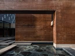 dl atelier builds museum with rammed earth walls near