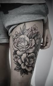 black ink flowers on thigh flower tats