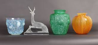 vases large ornaments and winter greenery with twigs in a white vase