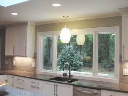 kitchen windows over sink large window over sink contemporary kitchen raleigh by anne paul