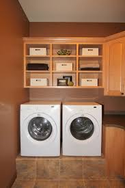 Laundry Room Storage Between Washer And Dryer by Several Must Have Washer And Dryer Cabinet Design That You Should