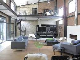 bureau en mezzanine 92 très beau loft dans un style industriel grand salon