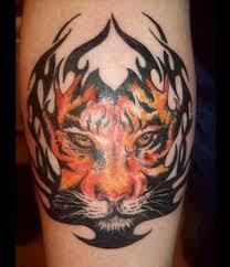 tribal tiger head tattoo on arm