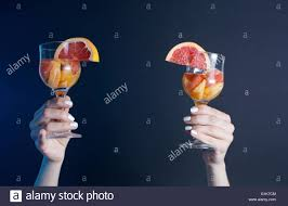 girls hand holding a cocktail drink at the party stock photo