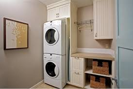 stacked washer dryer storage built in with custom wooden cabinet