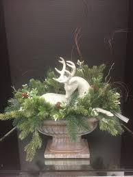 Make Christmas Greenery Decorations by Best 25 Christmas Floral Arrangements Ideas On Pinterest