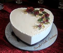 heart shaped wedding cakes heart shaped wedding cake with burgundy roses and flickr