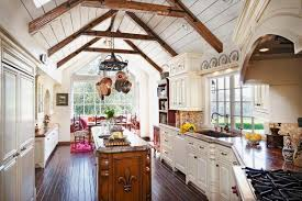 bright country style kitchen with white cabinetry and storage also