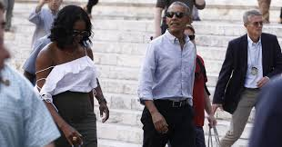 barack and michelle obama are casually exploring italy at the