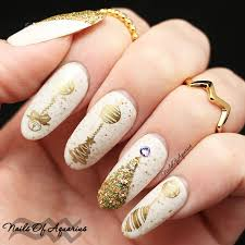 white nail design featuring girly bits