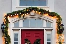 Christmas Decorations For Outside Door by Holiday Door Decorating Ideas For Your Small Porch The Home Depot