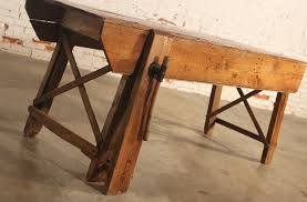 primitive industrial table workbench with attached wood vise