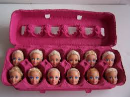 1 dozen egg head barbies
