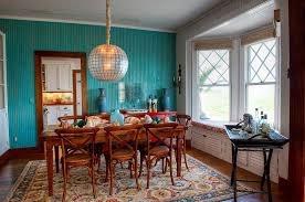 how high to hang a chandelier corner standing shelves ergonomic high back chairs brown metal