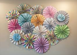 wedding backdrop on a budget guest post diy your own paper pinwheel backdrop with