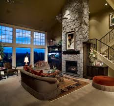 very large family room with stone fireplace area rug glass top