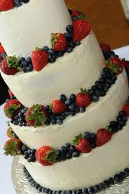 wedding cake recipes berry wedding cake with berries and silhouette toppers white wedding