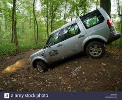 silver land rover discovery silver land rover discovery 4 driving through a forest at the