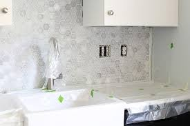 installing backsplash in kitchen how to install a marble hexagon tile backsplash just a and