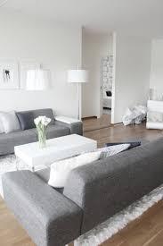 modern living room kept in white and grey scandanavian home