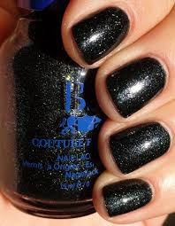 best black base olive green nail polish with emerald green glitter
