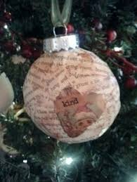 large plastic ornaments covered with tissue paper i punched out