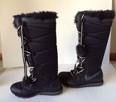 womens boots nike charms nike winter boots boots black pom pom s