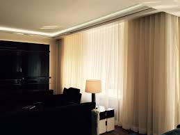 custom motorized shades and curtains by ny city blinds adorn this