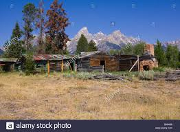 image of an abandoned ranch house in disrepair with piles of old