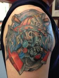 firefighter helmet flames and skull tattoos