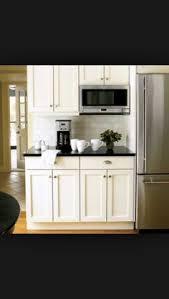kitchen microwave ideas microwave shelf dark quartz with white cabinets stainless