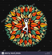 mandala made of tree leaves with silhouette doing yoga pose in