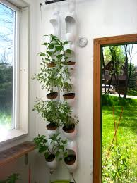 Self Watering Vertical Planters Plenty Of Basil Growing In Vertical Garden Made Out Of Recycled