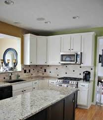 Remodeled Kitchen With Cathedral Arch Raised Panel Cabinet Doors - Oak kitchen cabinet makeover