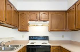 how to freshen up stained kitchen cabinets how to restore worn kitchen cabinets without a complete